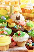 Easter cupcakes and Easter eggs display.  poster