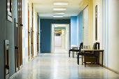 reception in hospital with corridor at night.