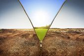 Open Zipper Showing Dry Land Landscape Changing To Green Land Landscape poster