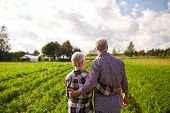farming, gardening, agriculture and people concept - happy senior couple at summer farm poster