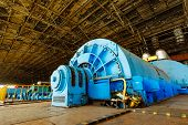 Interior Of Turbine Generator In A Big Power Plant. Hydroelectric Power Plant. poster