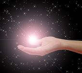 image of reach the stars  - an illustration of a hand holding a star - JPG