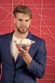 Man Hold Plate With Zephyr, Dessert. Businessman In Suit With Marshmallow, Food. Dessert, Confection poster