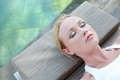 Portrait of woman relaxing in deck chair