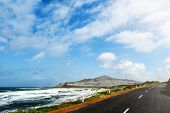 Coastal Road On Cape Peninsula Near Cape Town Against Rough Sea And Blue Sky poster