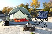 Camping Equipment Near Tent With Sleeping Bag Outdoors poster