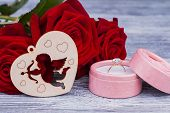 Romantic Background With Roses And Golden Ring. Engagement Ring In Box, Red Roses And Wooden Heart.  poster