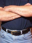 Man Folding Arms