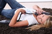 woman  phoning laid on the floor