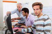 Men working on computers