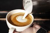 A Professional Barista Holds A Cup Of Coffee, Making A Beautiful Heart Shape Latte Art. Hot Art Latt poster