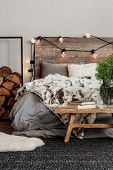 Trendy Bedroom Interior With King Size Bed And Fury Blanket poster