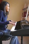 Cute Hispanic Girl Playing Piano