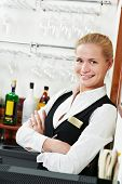 Happy beautiful restaurant manager barman administrator at work place