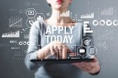 Apply Today With Business Woman Using A Tablet Computer poster