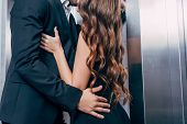 Cropped View Of Couple Passionately Kissing Near Elevator poster