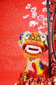 traditional chinese dancing-lion on a festive background,the lion is believed to be able to dispel e