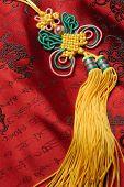 Artesanía oriental, tradicional nudo nudo chino de seda Jin background.lucky suerte rezar la seguridad