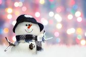 Festive snowman with Christmas light background