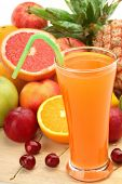 Closeup of fruit juice with fruits
