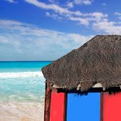 hut red palapa at turquoise beach of caribbean sea in a sunny blue sky day [ photo-illustration]