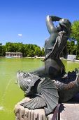 Madrid Sirena  Pez mermaid over fish statue in Retiro Park lake