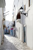 Ibiza downtown white houses narrow street in Mediterranean Spain