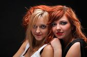 Two Happy Young Girlfriends Black Background