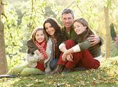 image of mid autumn  - Family Group Relaxing Outdoors In Autumn Landscape - JPG