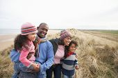picture of family fun  - Black Family on a beach - JPG