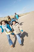 picture of family fun  - Family Running On Winter Beach - JPG
