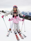 picture of ski boots  - Young Mother And Daughter On Ski Vacation - JPG