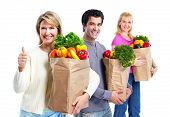 stock photo of grocery-shopping  - Happy people with a grocery shopping bag - JPG