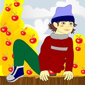 The boy climbs over the fence with stolen apples