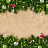 fir tree border with ornaments on a stained paper background - perfect for holiday greeting cards
