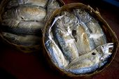 Steamed fish packed in bamboo basket