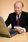 Senior Asian Businessman Shopping Online