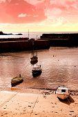 Fiery Sunset Over Cornish Harbor