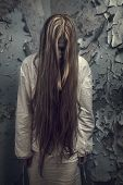 Zombie Girl With Loong Hair In An Abandoned Building