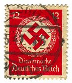 GERMANY - CIRCA 1941: A stamp printed in Germany shows image of the swastika  is an equilateral cros