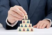 image of human pyramid  - Human resources officer realize gender equality by choosing woman boss employee  - JPG