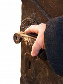 Hand On An Antique Door - Opening