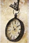 Vintage photo of old clock hanging on wall