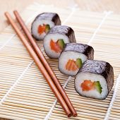 Delicious Fresh Sushi Rolls On The Mat