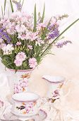 Vintage tea in elegant cups with flowers