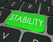 The word Stability on a computer keyboard key to illustrate financial security in investing money for the future, or safe and secure, stable network or architecture for software or programming