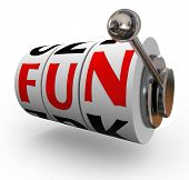 The word Fun on slot machine wheels or dials to illustrate entertainment and enjoyment of having a g