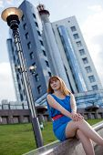 Beautiful Woman In Blue Dress Against Building