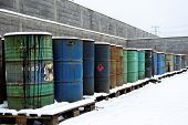 stock photo of dump  - Photo of a Chemical waste dump with a lot of barrels - JPG