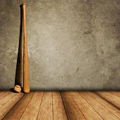 picture of baseball bat  - Lone baseball and bat against a concrete wall and wood floor - JPG
